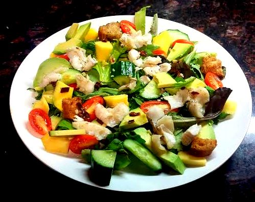 Avocado, mango and white fish salad